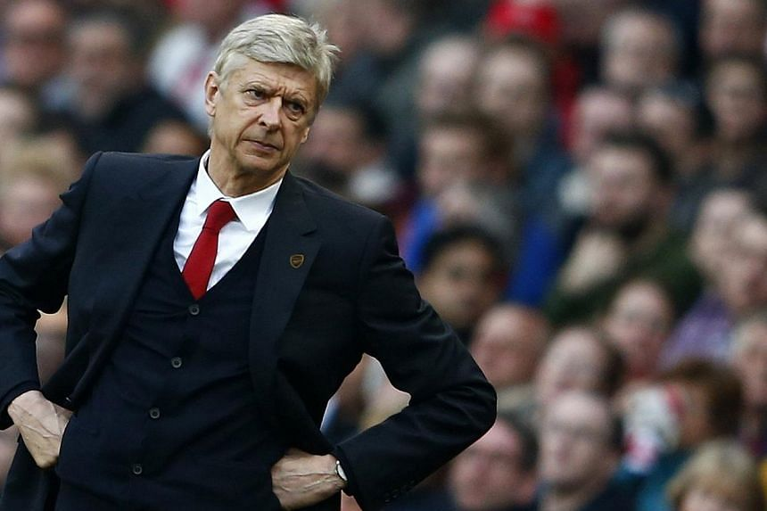 Arsenal's manager Arsene Wenger during their English Premier League soccer match against Manchester City at The Emirates Stadium in London on March 29, 2014. Wenger admits Arsenal will have only themselves to blame if they fail to qualify for next se