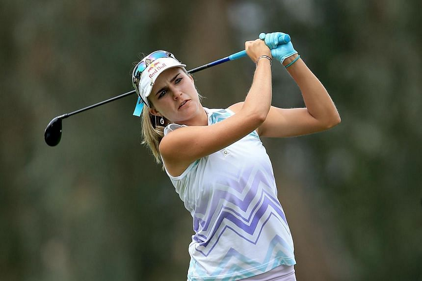 Lexi Thompson of the USA plays her second shot at the par 5, ninth hole during the second round of the 2014 Kraft Nabisco Championship on the Dinah Shore Tournament Course at Mission Hills Country Club on April 4, 2014, in Rancho Mirage, California.&