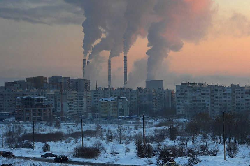 A file picture taken on Jan 31, 2012 in Sofia shows the sun rising behind chimneys of a thermal power station. World powers are running out of time to slash their use of high-polluting fossil fuels and stay below agreed limits on global warming,