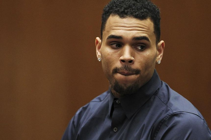 Singer Chris Brown appears for a probation progress hearing at the Clara Shortridge Foltz Criminal Justice Center in Los Angeles, California, on Feb 3, 2014. -- FILE PHOTO: REUTERS