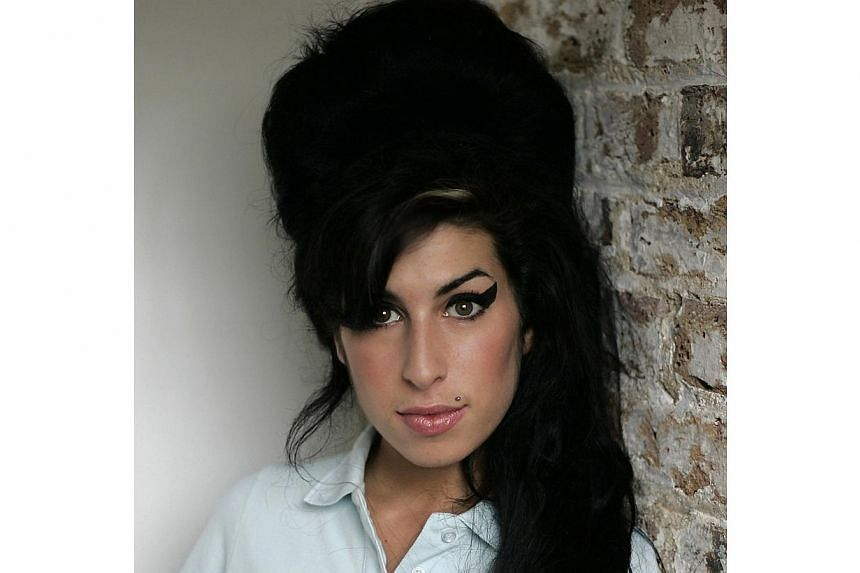 British singer Amy Winehouse, who died at the age of 27, in July 2011. -- FILE PHOTO:UNIVERSAL ISLAND