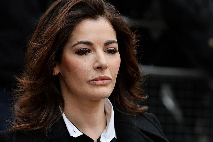 British television chef Nigella Lawson arrives at Isleworth Crown Court in west London on Dec 4, 2013, as she prepares to give evidence in a case in which her two personal assistants are accused of defrauding her and former husband Charles Saatchi. -