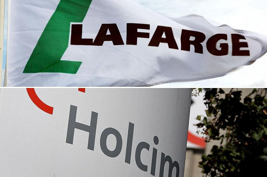 This combination of files pictures made on April 4, 2014, shows a file picture of the logo of the French building materials group Lafarge taken on July 17, 2009, in Paris, and a file picture of the logo of the cement company Holcim taken on Aug 23, 2