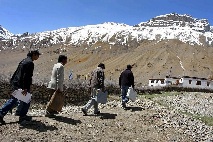 In this file photograph taken on May 12, 2009 Indian Election Commission officials carry electronic voting machines (EVM) to a polling booth at a tribal village in Kaza, located in the district of Lahaul-Spiti in Himachal Pradesh, on the eve of the f