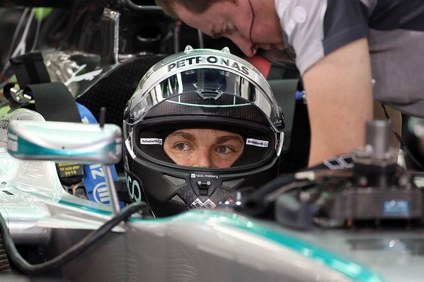 Mercedes AMG Petronas driver Nico Rosberg of Germany sits in his car prior to the start of the qualifying session of the Formula One Bahrain Grand Prix at Bahrain's Sakhir circuit in Manama on April 5, 2014. -- PHOTO: AFP