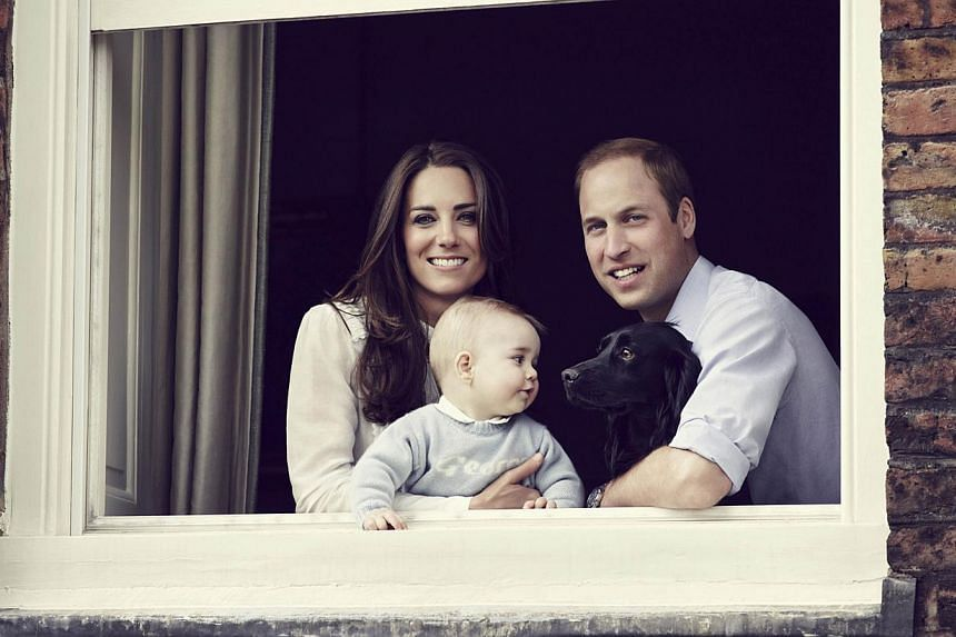In a handout picture released by Kensington Palace and Camera Press on March 29, 2014, Britain's Prince William (right), Duke of Cambridge, and Britain's Catherine (left), Duchess of Cambridge, pose with their son Prince George of Cambridge (centre)