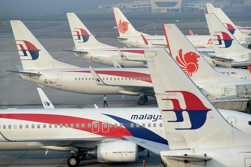 Malaysia Airlines planes parked at the terminal in Kuala Lumpur Intenational Airport (KLIA) in Sepang on March 30, 2014. Criminal investigators looking into the possibility of foul play by those on missing Malaysia Airlines flight MH370 may have