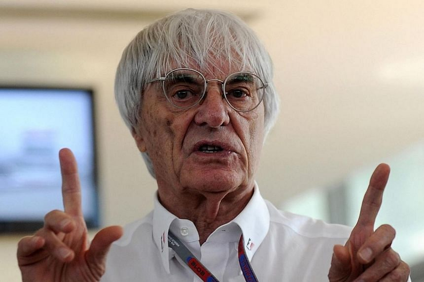In this picture taken on Oct 28, 2012, Formula One chief Bernie Ecclestone gestures as he speaks to media representatives prior to the Formula One Indian Grand Prix 2012 at the Buddh International circuit in Greater Noida, on the outskirts of New Del