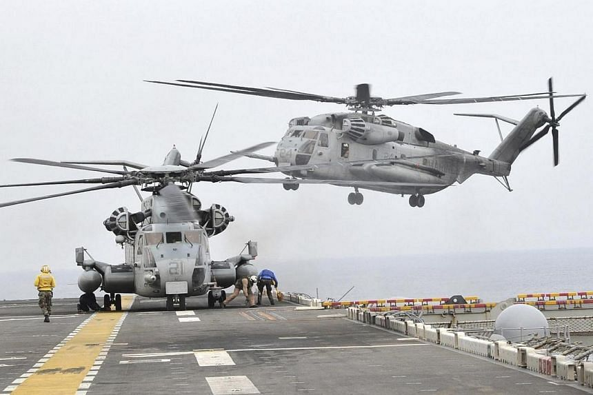 "A US helicopter takes off from the USS Bonhomme Richard LHD 6 in the sea off Pohang on March 31, 2014. North Korea has slammed the South's recent ballistic missile test, calling it a ""farce"" aimed at showing off Seoul's military strength in the"