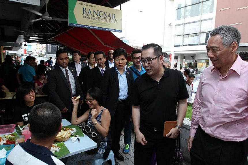 PM Lee Hsien Loong and his wife Mrs Lee went on a quick tour of Kuala Lumpur's most famous places on Sunday to catch up on the latest developments in the Malaysian capital, ahead of the Malaysia-Singapore leaders' retreat in Putrajaya in the evening.
