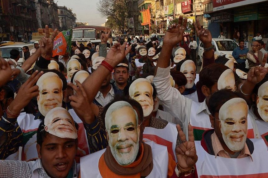 In this photograph taken on Feb 1, 2014, activists from India's Bharatiya Janata Party (BJP), clad in masks of BJP prime ministerial candidate and Gujarat state Chief Minister Narendra Modi, participate in a rally in Kolkata. India's political rivals