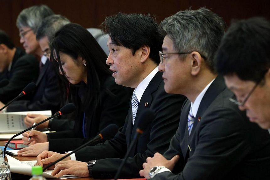 Japanese Defense Minister Itsunori Onodera (third from right) speaks during a meeting with US Secretary of Defense Chuck Hagel (not pictured) at the Japanese Minister of Defense headquarters in Tokyo on April 6, 2014. Japan's defence chief has o