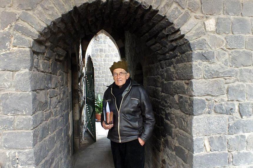 A file picture taken on February 2, 2014 shows Dutch Roman Catholic priest, Father Frans van der Lugt posing at the monastery of the Jesuit Fathers where he lived in the besieged area of Homs in Syria.A gunman in Syria's central city of Homs sh