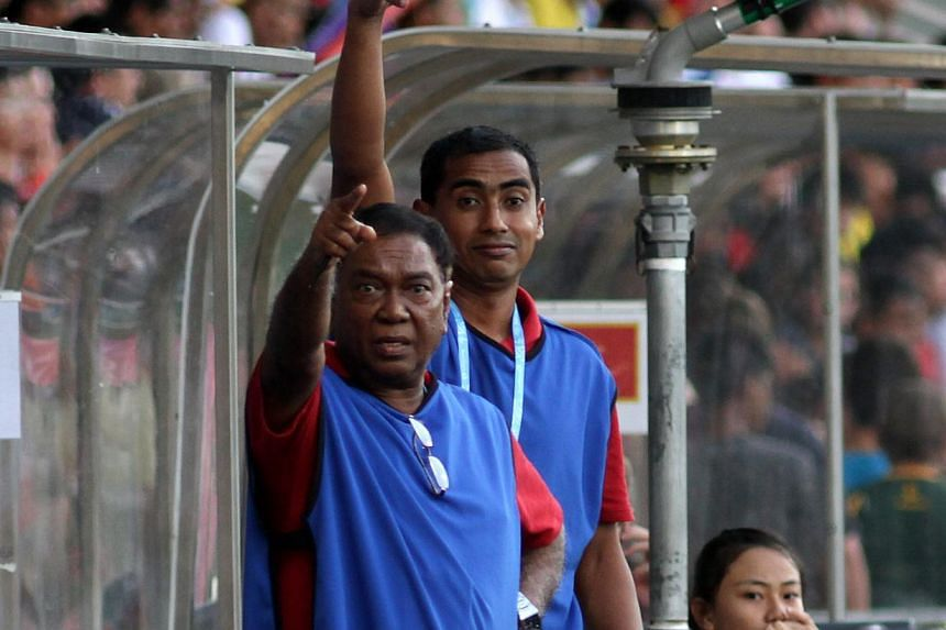 Singapore's Team Manager Jita Singh (front) and coach Abdul Kader Yahaya instructing their players during the football boys' bronze medal match between Singapore and Montenegro in the Singapore 2010 Youth Olympic Games (YOG) on Aug 25, 2010. Mr Singh