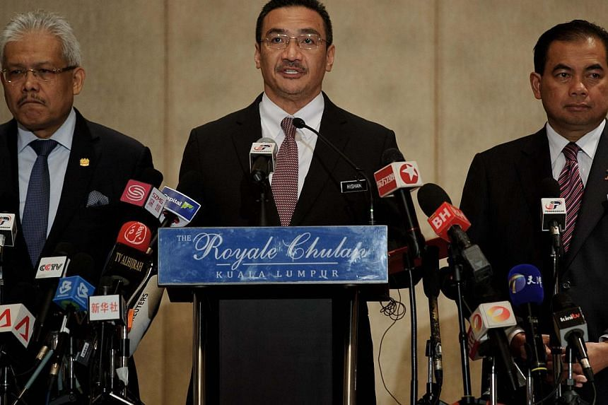 Malaysian Transport Minister Hishammuddin Hussein (centre) speaks during a press conference on the missing Malaysia Airlines flight MH370 in Kuala Lumpur on April 7, 2014. -- PHOTO: AFP