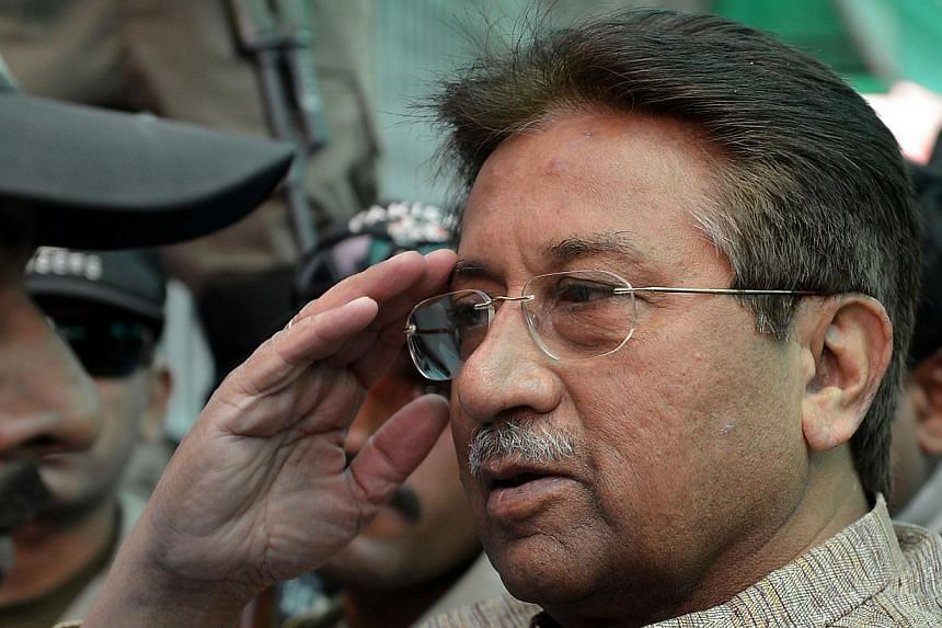 In this photograph taken on April 20, 2013, former Pakistani president Pervez Musharraf (centre) salutes as he is escorted by military personnel on his arrival at an anti-terrorism court in Islamabad. A Pakistani court hearing the murder case of a sl
