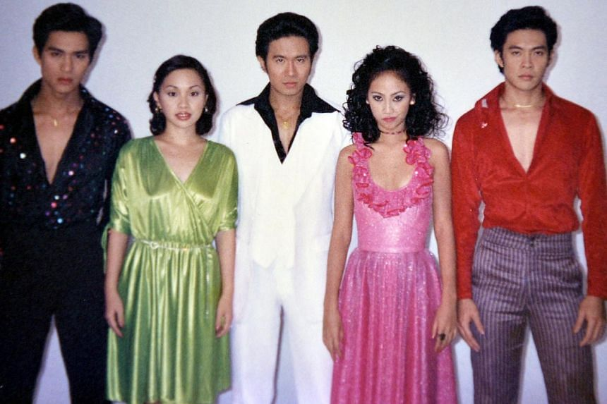Barber (second from left) in 1997 with the cast of movie Forever Fever (from left) Pierre Png, Adrian Pang, Annabelle Francis and Steven Lim, and on holiday in England with husband Wez Barber and daughters Alicia and Elizabeth. -- PHOTO: COURTESY OF