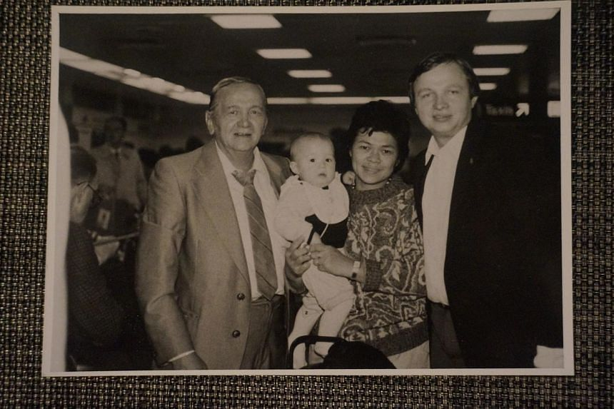 A photo of Ms Turzynski being carried by her mother. On the right is her father Kazimierz Turzynski, and on the left is her grandfather Mieczyslaw Turnzynski. Ms Turzynski was 17 months old when her parents and grandfather were killed. When police fo