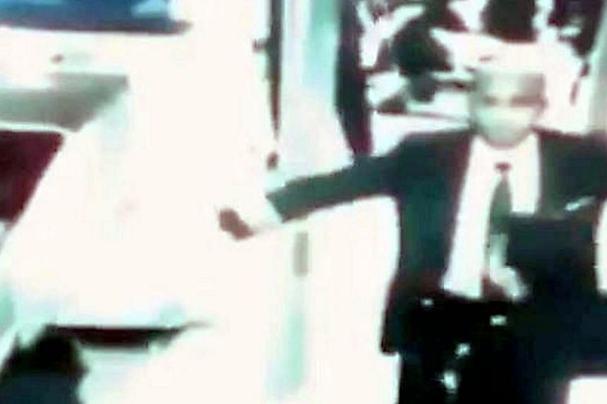 Screenshot from a closed-circuit television (CCTV) footage, supposedly of Captain Zaharie Ahmad Shah, who piloted the missing Malaysia Airlines (MAS) MH370, going through security checks at the Kuala Lumpur International Airport (KLIA) prior to board