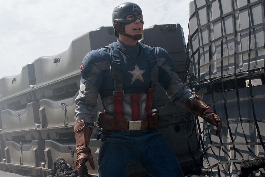 Captain America: The Winter Soldier, starring Chris Evans,pulled in a hefty US$96.2 million (S$121 million). -- PHOTO:DISNEY/MOVIE STILL