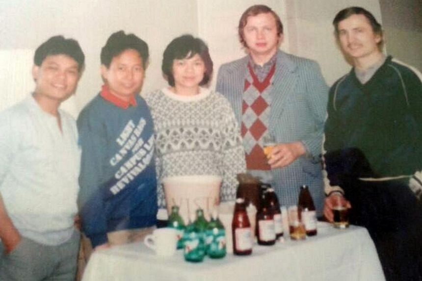 (From left) Ms Turzynski's mother's Singaporean deaf friends, her mother Lee Kui Yin, her father Kazimierz and his brother Andrzej. -- PHOTO: COURTESY OF COLLEEN TURZYNSKI