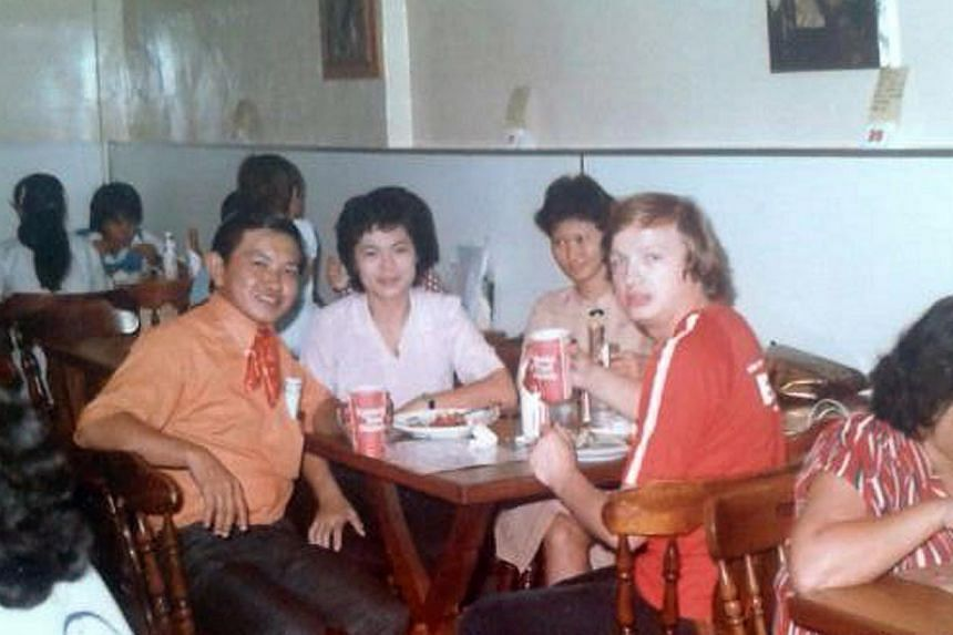Ms Turzynski's mother in white and father in red, with friends or relatives in Singapore.-- PHOTO: COURTESY OFCOLLEEN TURZYNSKI