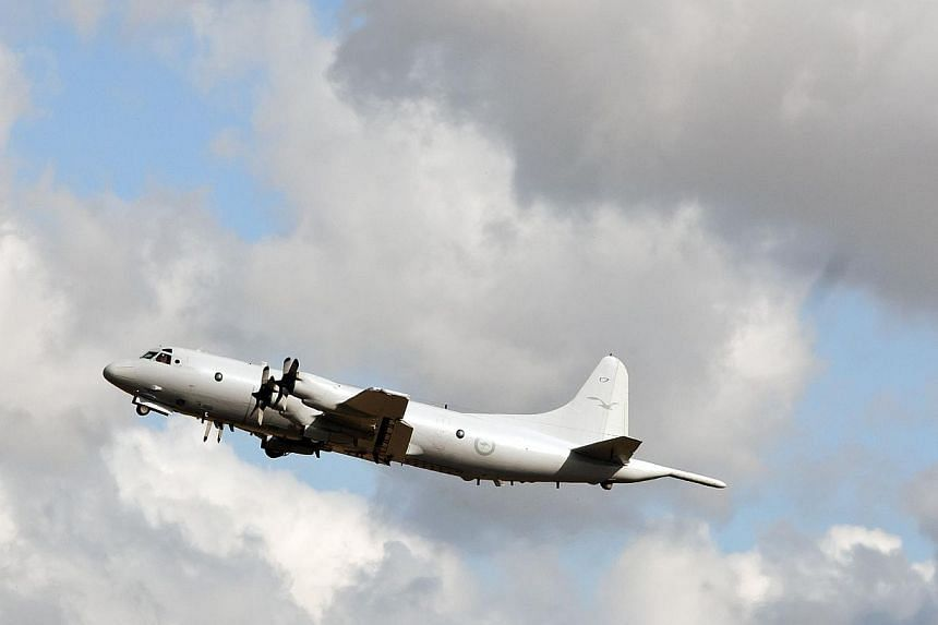 An Australian Air Force Orion takes off from Pearce Airbase in Bullsbrook, 35km north of Perth, to join the hunt for MH370 in the Indian Ocean on April 6, 2014. -- PHOTO: AFP