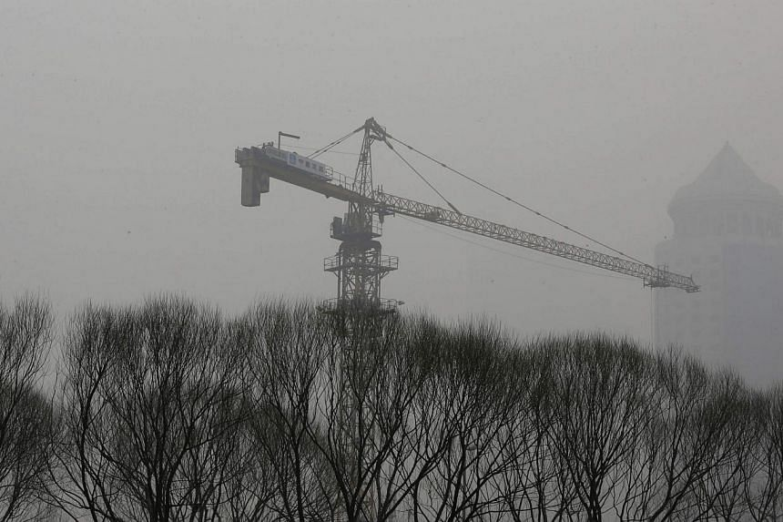 A crane is seen at a construction site amid the heavy haze in Beijing's central business district, on February 26, 2014. China's capital Beijing will set up cameras at building sites across the city to monitor how much construction contributes to Bei