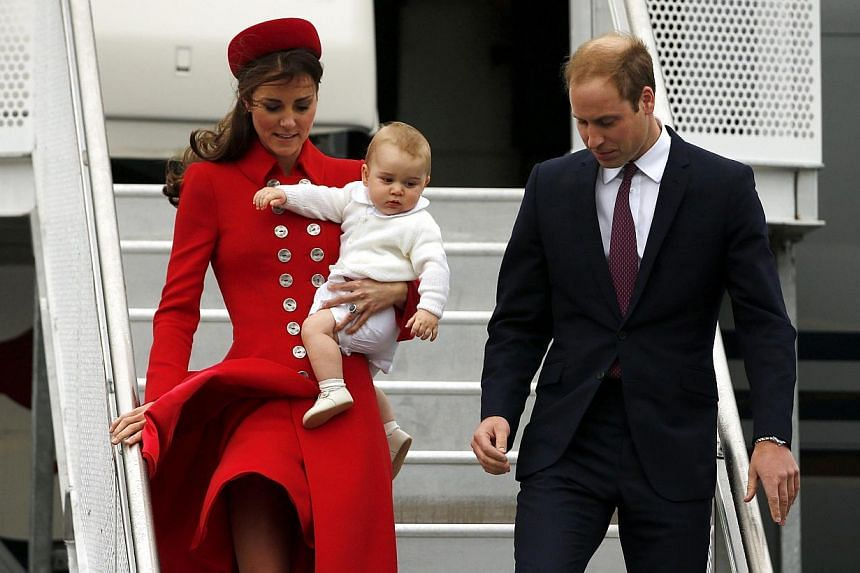 Britain's Prince William, his wife Catherine, Duchess of Cambridge, and their son Prince George disembark from their plane after arriving in Wellington, on April 7, 2014. -- PHOTO: REUTERS
