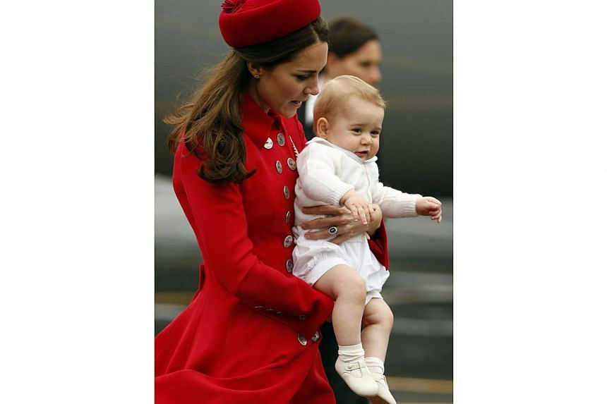Catherine, the Duchess of Cambridge, holds her son Prince George after disembarking their plane with her husband Britain's Prince William in Wellington, on April 7, 2014. -- PHOTO: REUTERS