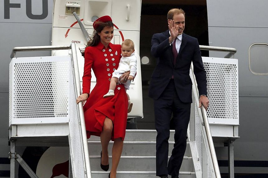 Britain's Prince William, his wife Catherine, Duchess of Cambridge and their son Prince George disembark from their plane after arriving in Wellington, on  April 7, 2014. The Duke and Duchess of Cambridge are breaking in Prince George early. The