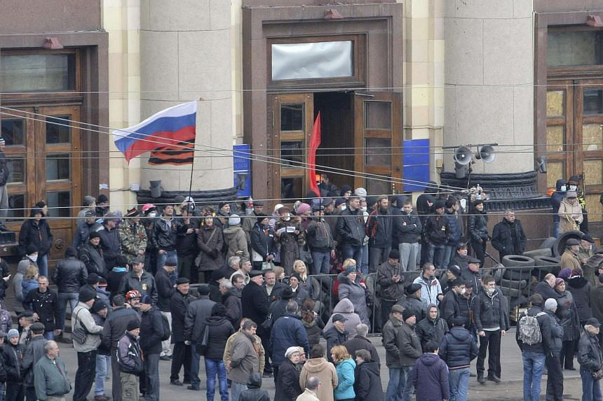 Pro-Russian protesters gather outside the regional administrative building in the eastern city of Kharkiv, on April 7, 2014. The United States ambassador to the Organisation for Security and Cooperation in Europe (OSCE) said Russia had amassed tens o