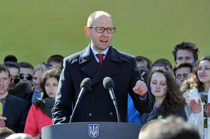 """Ukraine's Prime Minister Arseniy Yatsenyuk delivers a speech during a convention of Batkivshchyna (""""Fatherland"""") party in Kiev on March 29, 2014. Ukraine's embattled prime minister on Monday, April 7, 2014, accused Russia of trying to """"dismember"""" his"""