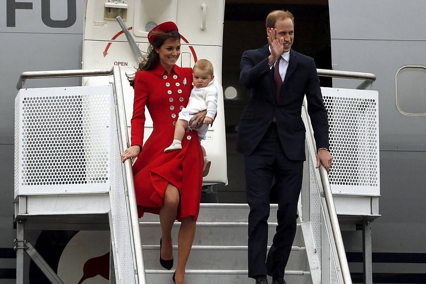 Britain's Prince William, his wife Catherine, Duchess of Cambridge and their son Prince George disembark from their plane after arriving in Wellington on April 7, 2014. -- PHOTO: REUTERS