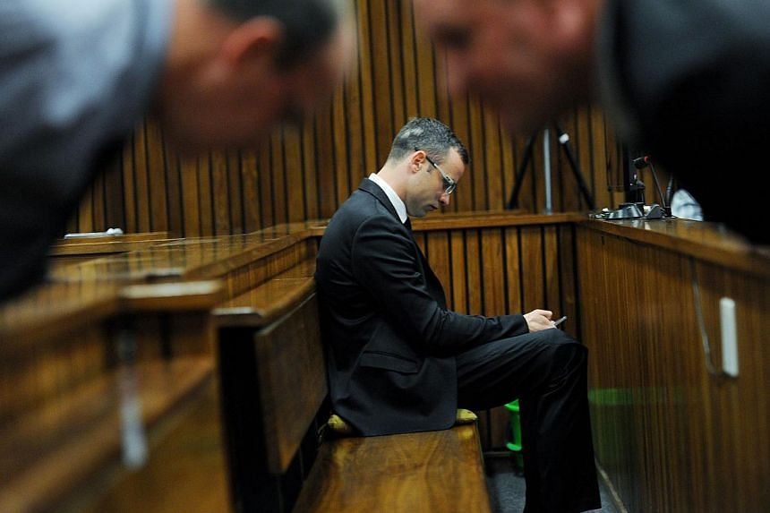 "Pistorius has cut a lonely figure since his trial started on March 3, saying little since his ""not guilty"" plea besides the occasional ""yes, milady"" to Judge Thokozile Masipa. -- FILE PHOTO: AFP"