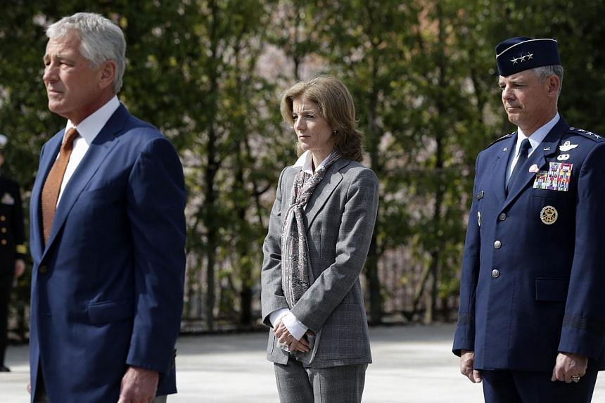 (From left) US Secretary of Defence Chuck Hagel, US Ambassador to Japan Caroline Kennedy and Commander of US Force Japan Lieutenant General Salvatore Angelella observing a moment of silence after Mr Hagel laid a wreath at the JSDF Memorial at the Jap