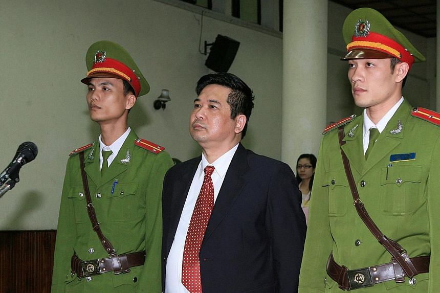 This file picture taken on April 4, 2011 shows French-trained prominent dissident and legal expert Cu Huy Ha Vu (Center) in court in Hanoi during his trial.One of Vietnam's most prominent dissidents, who was jailed after trying to sue the prime