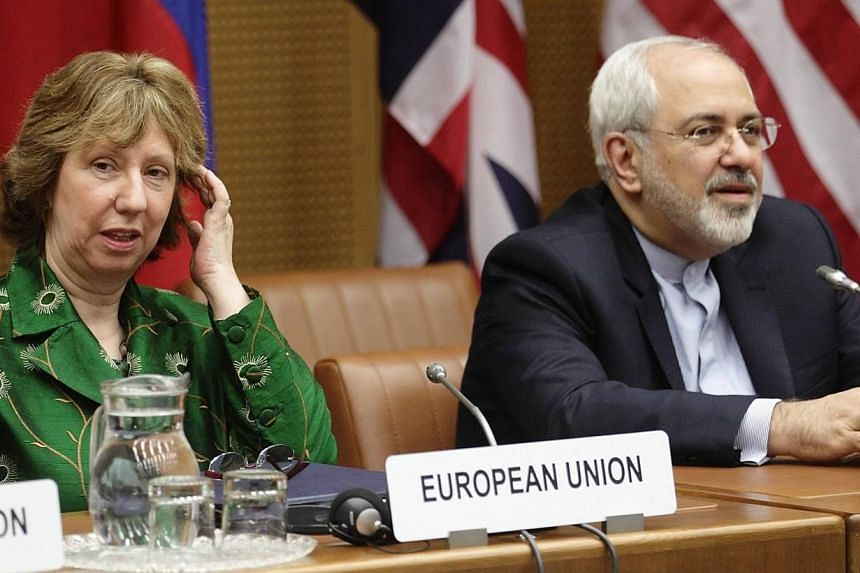 European Union foreign policy chief Catherine Ashton (Left) and Iranian Foreign Minister Mohammad Javad Zarif smile at the start of talks in Vienna April 8, 2014. Iran and world powers embarked on a new round of nuclear talks on Tuesday hoping t