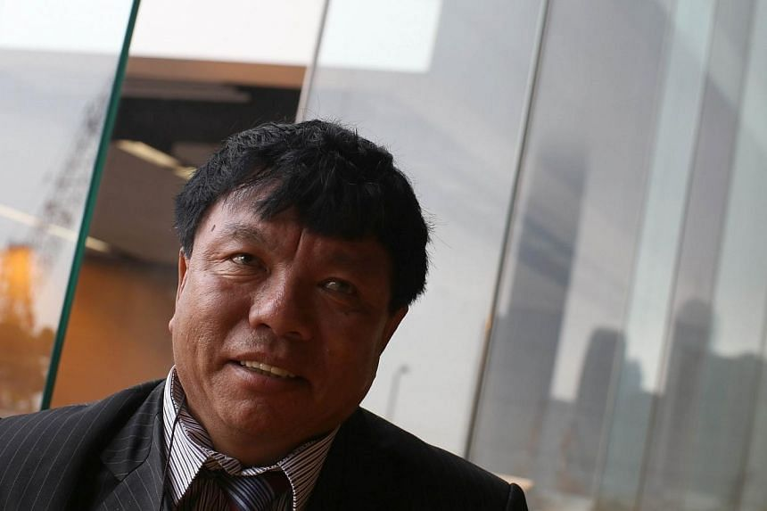 Nepalese Internet pioneer Mahabir Pun smiles during an interview with AFP in Hong Kong on Tuesday, April 8, 2014. A Nepalese educator who transformed the way of life in more than 150 remote Himalayan villages by connecting them to the Internet w