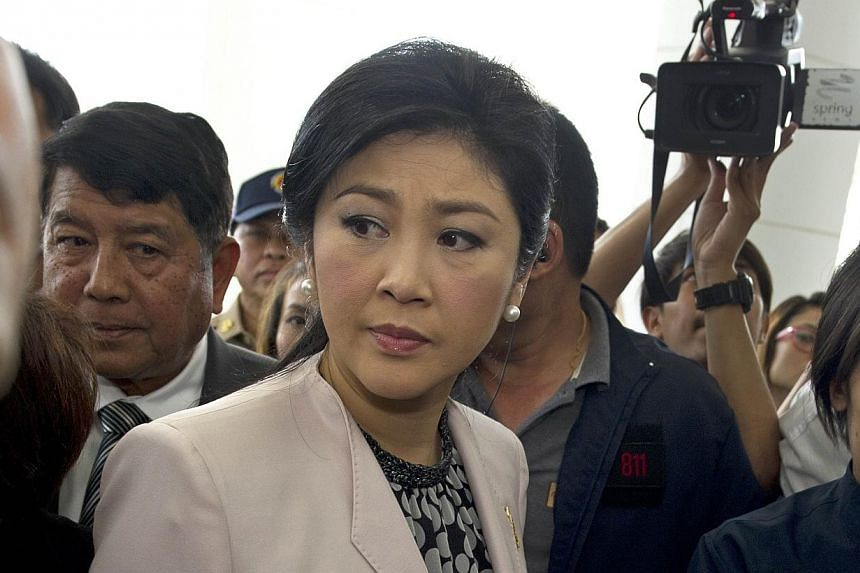 Thai Prime Minister Yingluck Shinawatra (Center) arrives at the National Anti-Corruption Commission (NACC) in Nonthaburi province on March 31, 2014. With legal cases against her mounting, embattled Thai Prime Minister Yingluck Shinawatra pleaded