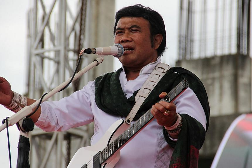 Mr Rhoma Irama, the self-styled Dangdut King of Indonesia, performing in a political rally cum concert in Banda Aceh on March 16, 2014, on his election campaign trail for the National Awakening Party (PKB) for the Indonesia Elections 2014. -- ST FILE