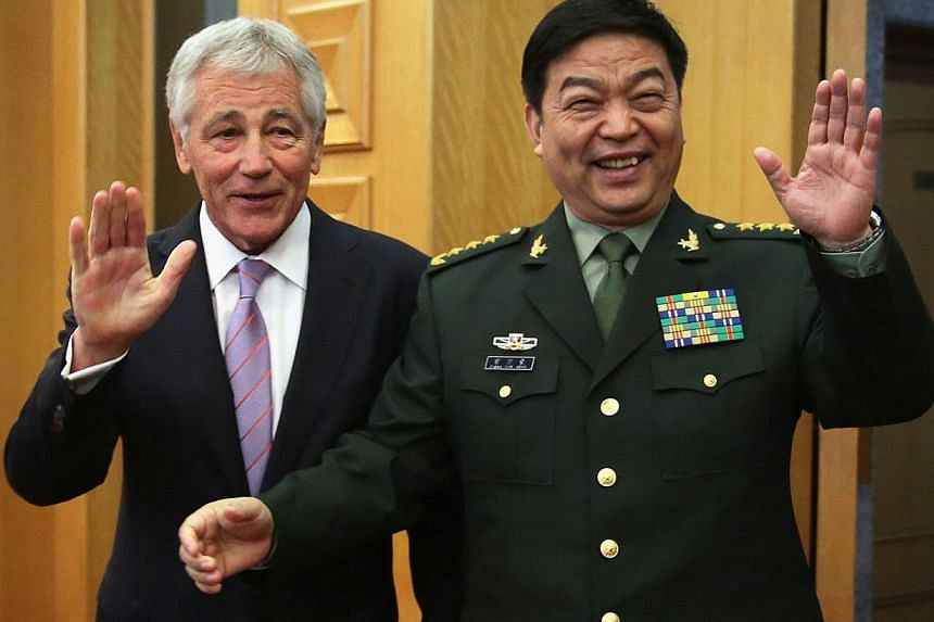US Defense Secretary Chuck Hagel (left) and Chinese Minister of Defense Chang Wanquan gesture to members of the media prior to their meeting at the Chinese Defense Ministry headquarters in Beijing on April 8, 2014.Beijing will not act first to