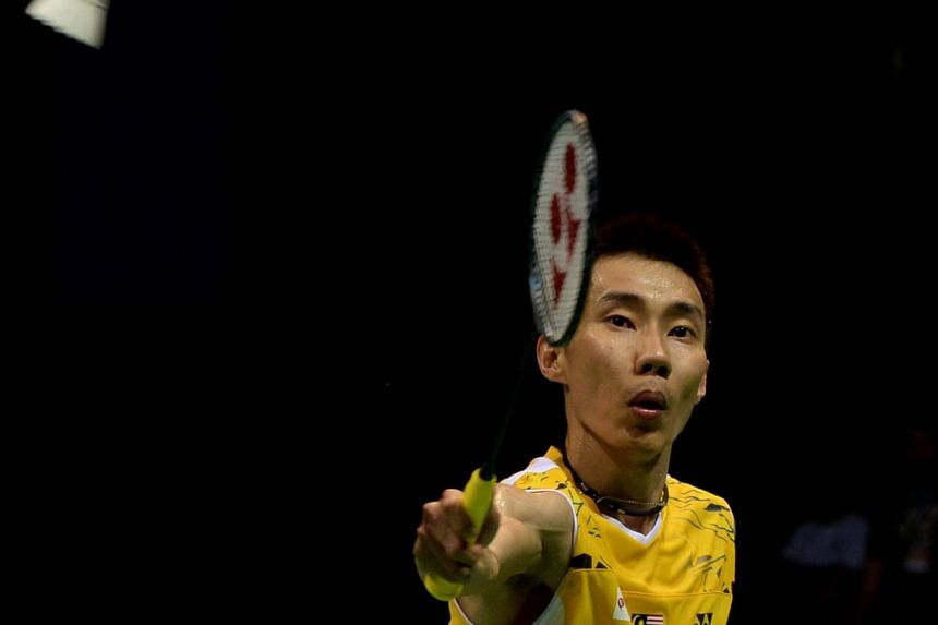 Lee Chong Wei of Malaysia returns a shot from Chen Long of China during the Yonex-Sunrise men's singles final badminton match at the Siri Fort Sports Complex in New Delhi on April 6, 2014. Malaysia's world No. 1 badminton player Lee Chong Wei has rul