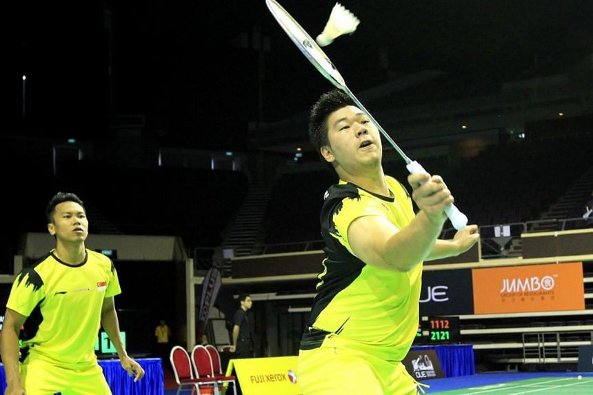 Singapore's Danny Bawa Chrisnanta (left) and Chayut Triyachart in their match againstIndonesia's Saputra Albert and Yonathan Suryatama Dasuki atthe OUE Singapore Open on April 8, 2014. The pair were one of four doubles teams from th