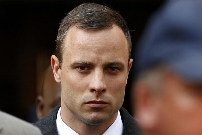Oscar Pistorius leaves after attending his trial at the high court in Pretoria, on April 7, 2014. Star Paralympian Oscar Pistorius returned to the witness box to testify in his murder trial Tuesday, on April 8, 2014, after an emotional first day