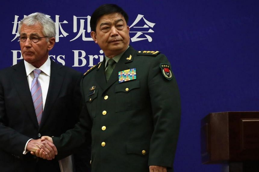 US Secretary of Defense Chuck Hagel (left) and Chinese Minister of Defense Chang Wanquan (right) shake hands at the end of a news conference at the Chinese Defense Ministry headquarters in Beijing on April 8, 2014. China called on the United States o