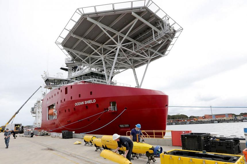 Workers assemble a Blue Fin 21 automatic Underwater Vehicle, an autonomous sonar mapping device, which will be towed behind the Australian Defence Vessel 'Ocean Shield' during search operations for missing Malaysia Airlines flight MH370 at naval base