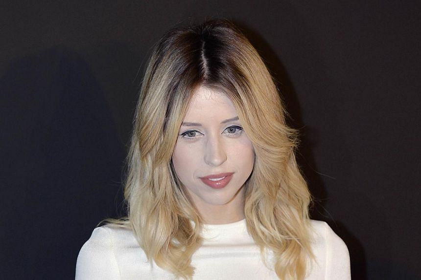 British TV host and model Peaches Geldof poses prior to the start of the Etam 2014/2015 Autumn/Winter collection fashion show, on February 25, 2014 in Paris. --PHOTO: AFP