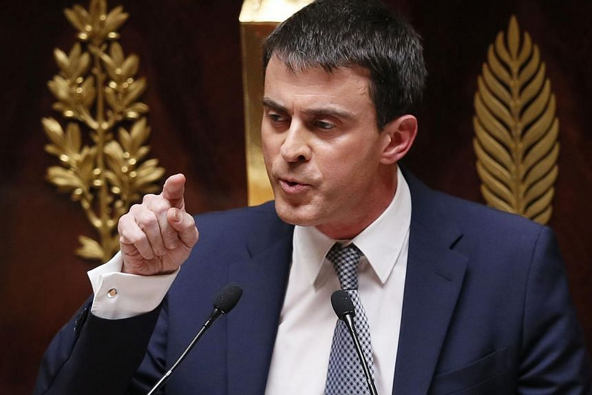 France's newly appointed Prime Minister Manuel Valls addresses members of the Parliament during his domestic policy speech, on April 8, 2014 at the French national assembly in Paris.France's new Prime Minister on Tuesdayvowed to slash lab