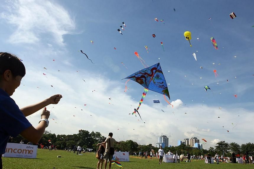 Some 6,000 kites - including a yellow one shaped like a guitar - filled the skies at West Coast Park.Public holiday dates for 2015, released by the Manpower Ministry today, show that seven out of the 11 holidays fall on Friday, Sunday or Monday